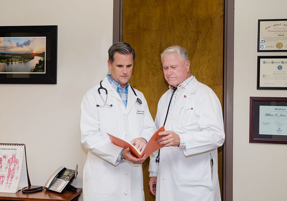 Dr. William Jones and Dr. Mason Jones in their medical office.